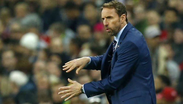 Gesturing to his players: Gareth Southgate