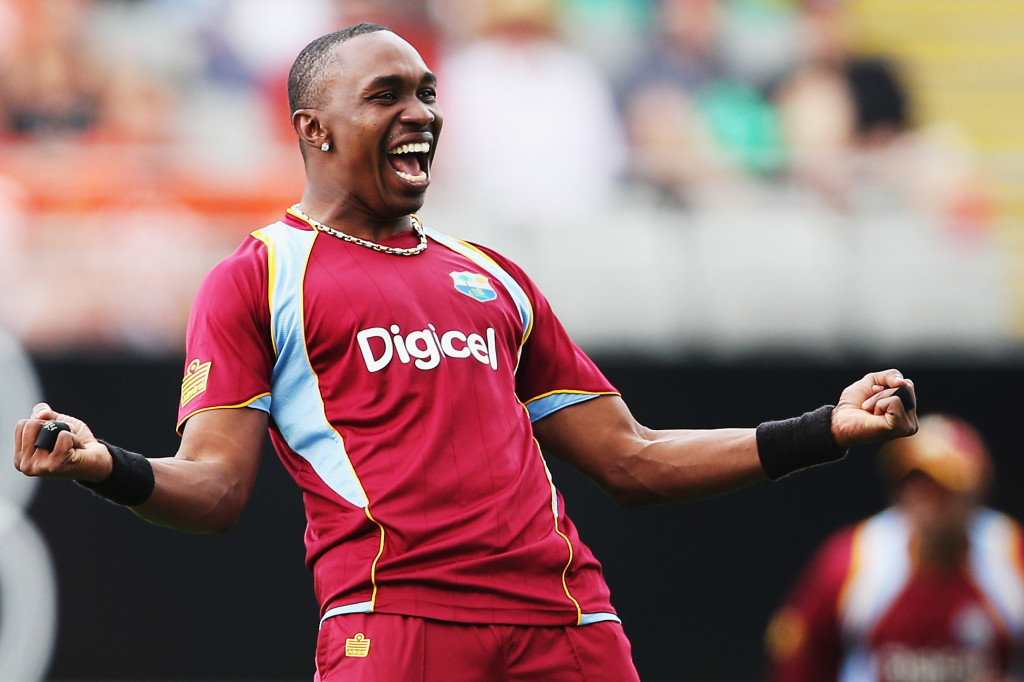AUCKLAND, NEW ZEALAND - DECEMBER 26: Dwayne Bravo of the West Indies celebrates the wicket of Brendon McCullum of New Zealand during the first One Day International match between New Zealand and the West Indies at Eden Park on December 26, 2013 in Auckland, New Zealand. (Photo by Hannah Peters/Getty Images)