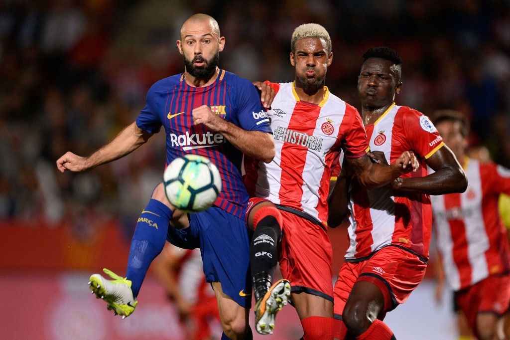 Barcelona's defender from Argentina Javier Mascherano (L) vies with Girona's defender Jonas Ramalho (C) and Girona's Kenyan forward Michael Olunga during the Spanish league football match Girona FC vs FC Barcelona at the Montilivi stadium in Girona on September 23, 2017. / AFP PHOTO / Josep LAGO (Photo credit should read JOSEP LAGO/AFP/Getty Images)