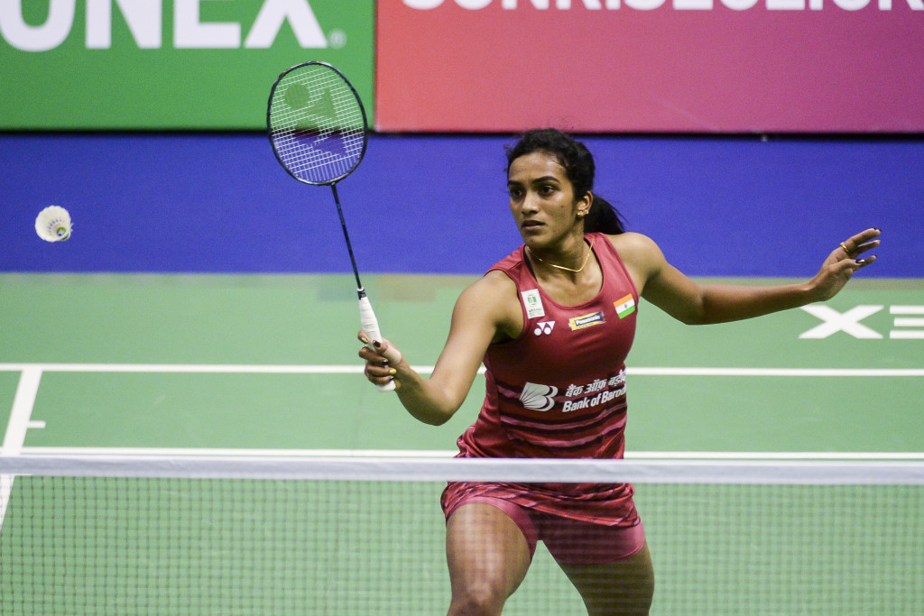 India's Pusarla V. Sindhu hits a shot against apan's Akane Yamaguchi during their quarterfinal women's singles matc at the Hong Kong Open badminton tournament in Hong Kong on November 24, 2017. / AFP PHOTO / ISAAC LAWRENCE (Photo credit should read ISAAC LAWRENCE/AFP/Getty Images)