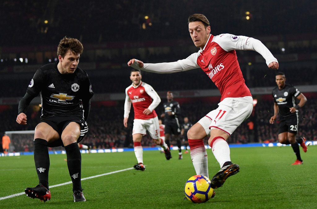 Mesut Ozil digs out a cross