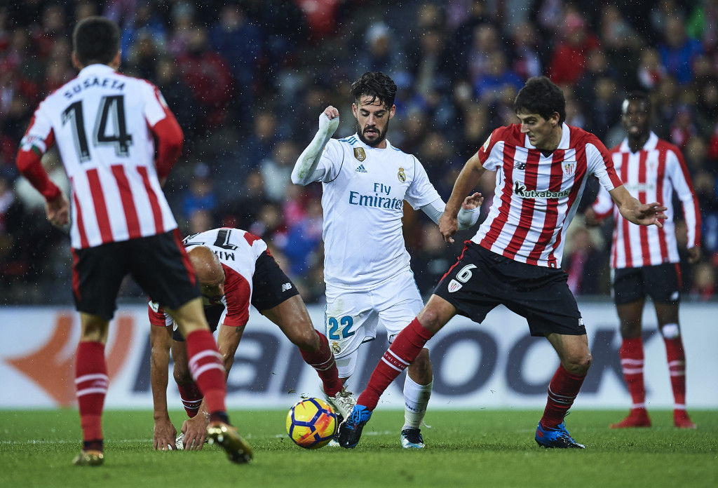 BILBAO, SPAIN - DECEMBER 02: Isco Alarcon of Real Madrid CF (C) being followed by Mikel Rico of Athletic Club (L) and Mikel San Jose of Athletic Club (R) during the La Liga match between Athletic Club and Real Madrid at Estadio de San Mames on December 2, 2017 in Bilbao, Spain. (Photo by Juan Manuel Serrano Arce/Getty Images)