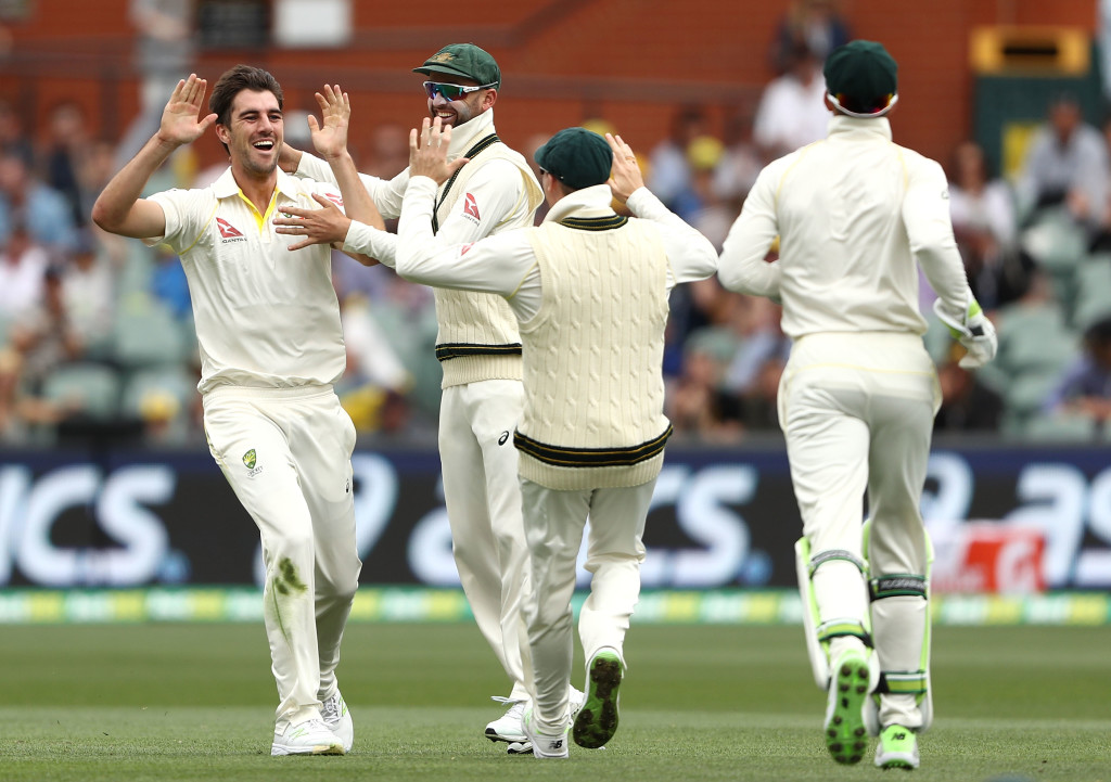 ADELAIDE, AUSTRALIA - DECEMBER 04:  Pat Cummins of Australia celebrates with Nathan Lyon of Australia after claiming the wicket of Joe Root of England  during day three of the Second Test match during the 2017/18 Ashes Series between Australia and England at Adelaide Oval on December 4, 2017 in Adelaide, Australia.  (Photo by Ryan Pierse/Getty Images)
