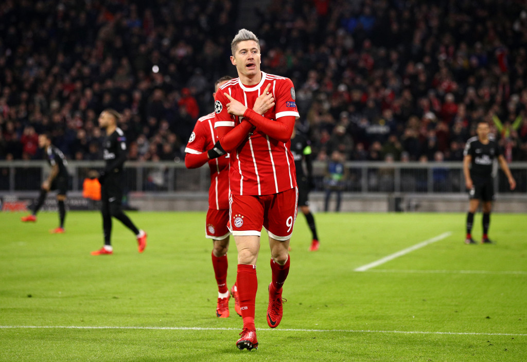 MUNICH, GERMANY - DECEMBER 05: Robert Lewandowski of Bayern Muenchen celebrates after scoring his sides first goal during the UEFA Champions League group B match between Bayern Muenchen and Paris Saint-Germain at Allianz Arena on December 5, 2017 in Munich, Germany. (Photo by Adam Pretty/Bongarts/Getty Images)