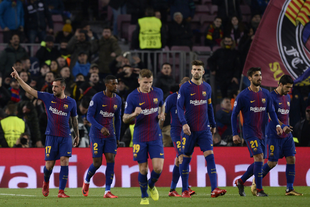 Barcelona's Spanish forward Paco Alcacer (L) celebrates with teammates after scoring a goal during the UEFA Champions League football match FC Barcelona vs Sporting CP at the Camp Nou stadium in Barcelona on December 5, 2017. / AFP PHOTO / Josep LAGO (Photo credit should read JOSEP LAGO/AFP/Getty Images)