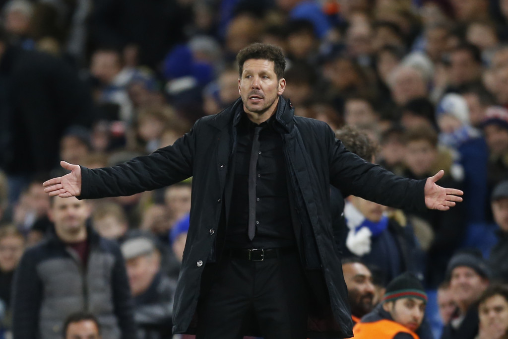 Atletico Madrid's Argentinian coach Diego Simeone gestures during a UEFA Champions League Group C football match between Chelsea and Atletico Madrid at Stamford Bridge in London on December 5, 2017. / AFP PHOTO / Ian KINGTON        (Photo credit should read IAN KINGTON/AFP/Getty Images)