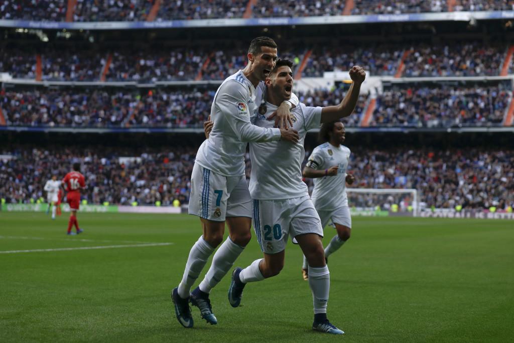 Cristiano Ronaldo celebrates with Marco Asensio