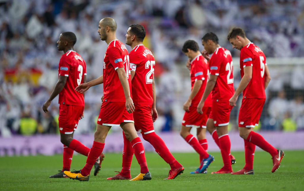 Sevilla players leave the pitch