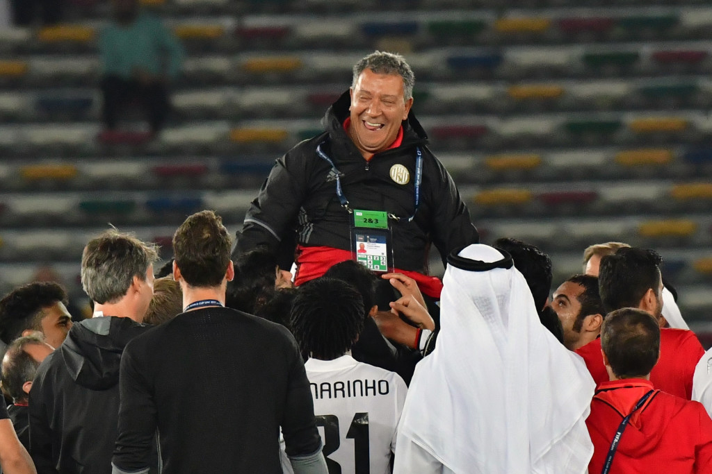 Al-Jazira players celebrate with Henk ten Cate after victory over Urawa Red Diamonds
