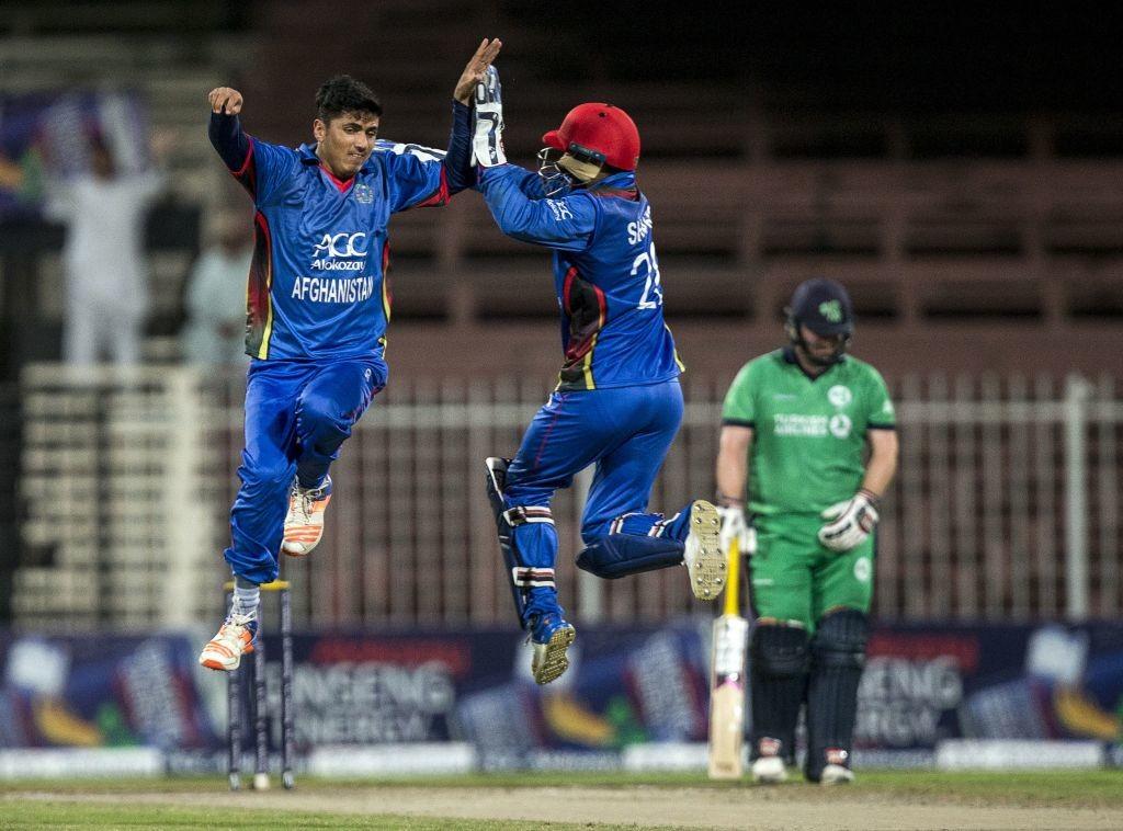 Afghanistan's Mujeeb Zadran (L) celebrates