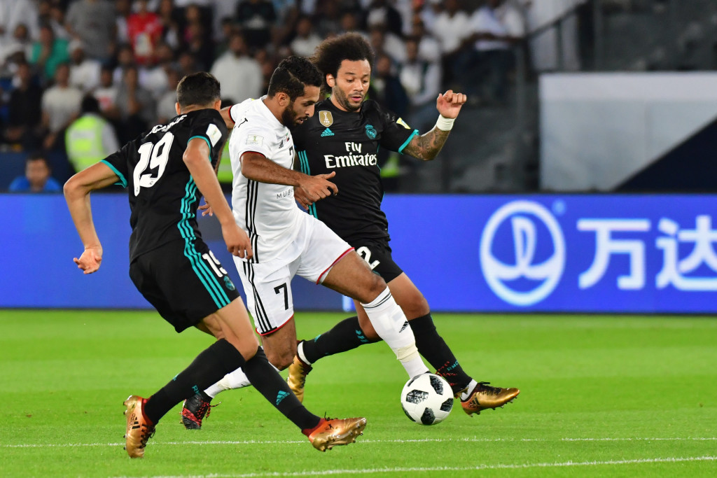 Ali Mabkhout (C) takes on Marcelo (R) and Achraf Hakimi (L)