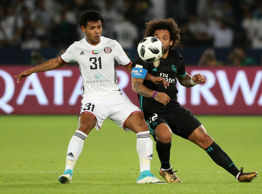 Real Madrid's Brazilian defender Marcelo (R) vies for the ball with al-Jazira's Brazilian forward Romarinho during the FIFA Club World Cup semi-final match in the Emirati capital Abu Dhabi on December 13, 2017. / AFP PHOTO / KARIM SAHIB (Photo credit should read KARIM SAHIB/AFP/Getty Images)