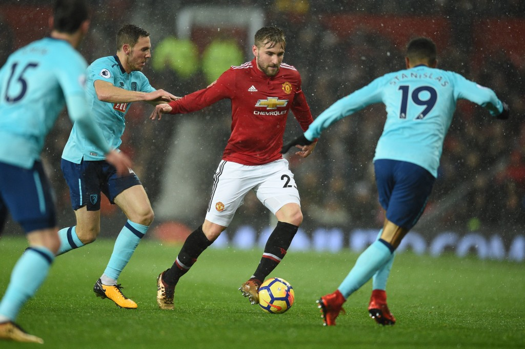 Luke Shaw (C) vies with Bournemouth's Junior Stanislas