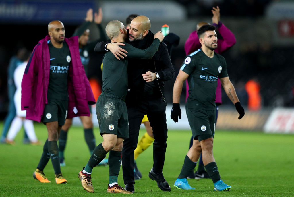 Pep Guardiola celebrates with his players after full time