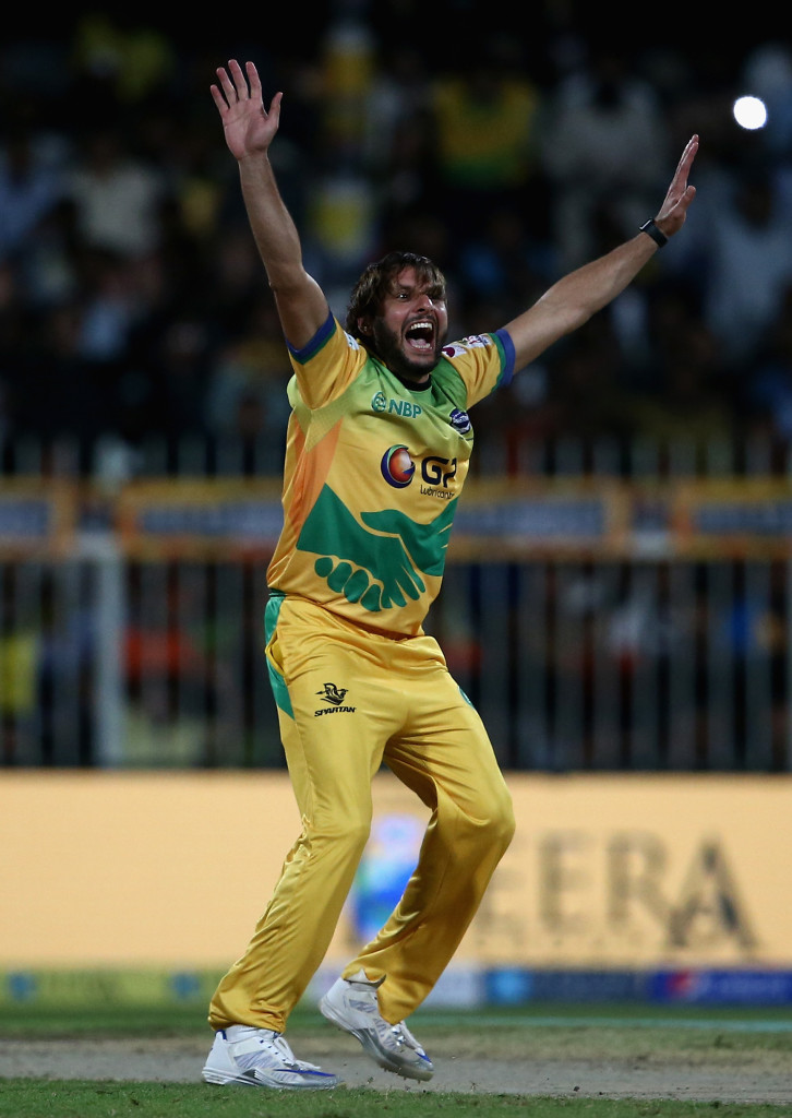 SHARJAH, UNITED ARAB EMIRATES - DECEMBER 14:  Shahid Afridi of Pakhtoons celebrate with team mates after taking a hat-trick during the T10 League match between Maratha Arabians and Pakhtoons at Sharjah Cricket Stadium on December 14, 2017 in Sharjah, United Arab Emirates.  (Photo by Francois Nel/Getty Images)