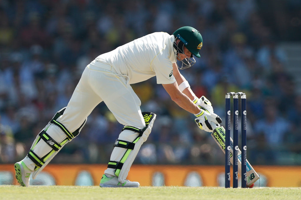 Smith prevents the ball from rolling onto the stumps.