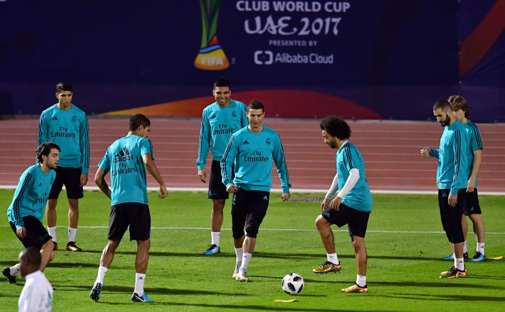 Real Madrid's Portuguese forward Cristiano Ronaldo (C) takes part in a training session with his teammates on the eve of their FIFA Club World Cup final football match at Zayed Sports City Stadium in the Emirati capital Abu Dhabi on December 15, 2017. / AFP PHOTO / Giuseppe CACACE (Photo credit should read GIUSEPPE CACACE/AFP/Getty Images)