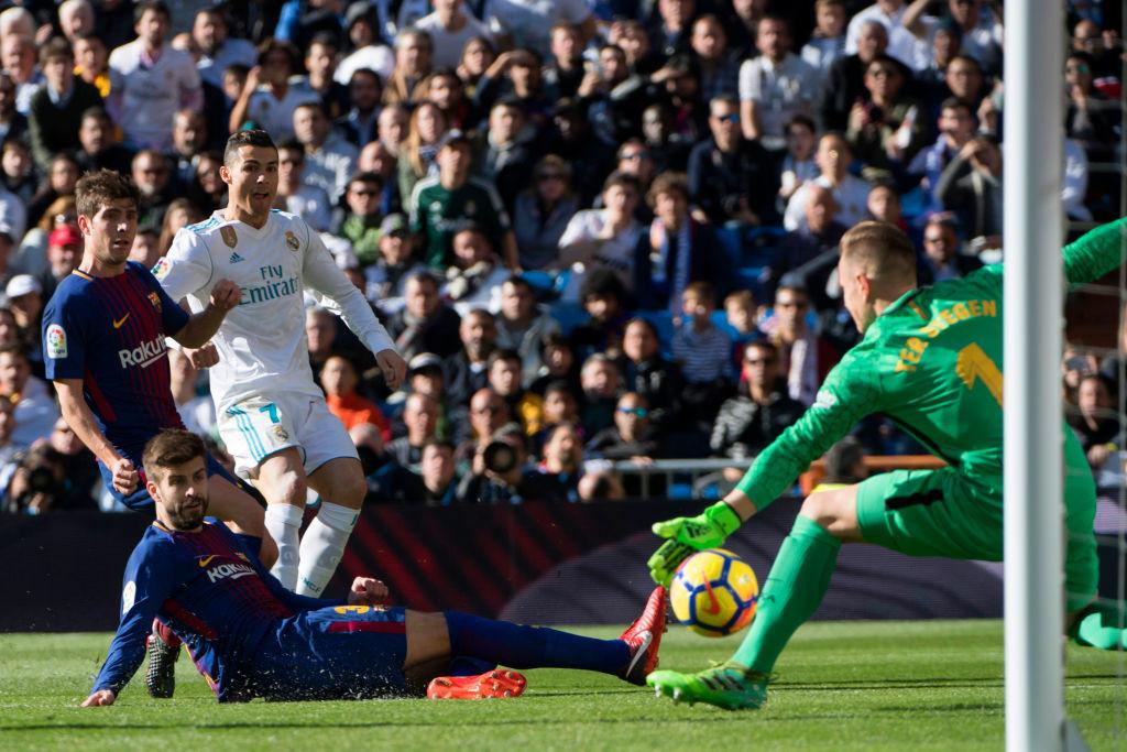 Marc-Andre Ter Stegen (R) denies Ronaldo