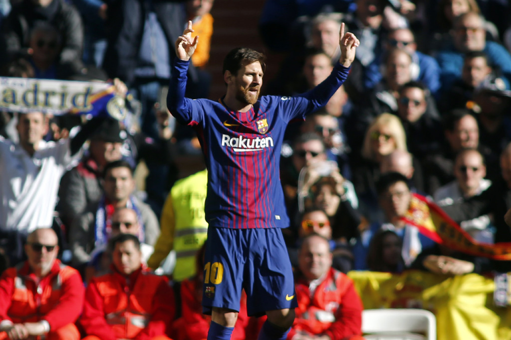 "Barcelona's Argentinian forward Lionel Messi celebrates after scoring during the Spanish League ""Clasico"" football match Real Madrid CF vs FC Barcelona at the Santiago Bernabeu stadium in Madrid on December 23, 2017. / AFP PHOTO / OSCAR DEL POZO (Photo credit should read OSCAR DEL POZO/AFP/Getty Images)"