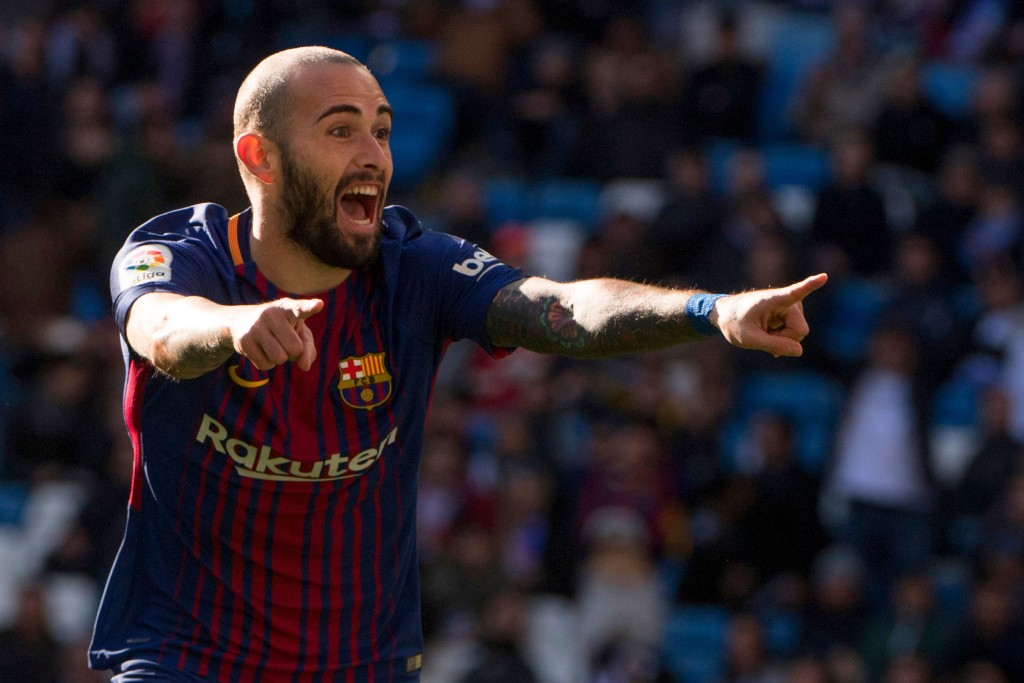 "Barcelona's Spanish midfielder Aleix Vidal celebrates after scoring during the Spanish League ""Clasico"" football match Real Madrid CF vs FC Barcelona at the Santiago Bernabeu stadium in Madrid on December 23, 2017. / AFP PHOTO / CURTO DE LA TORRE (Photo credit should read CURTO DE LA TORRE/AFP/Getty Images)"
