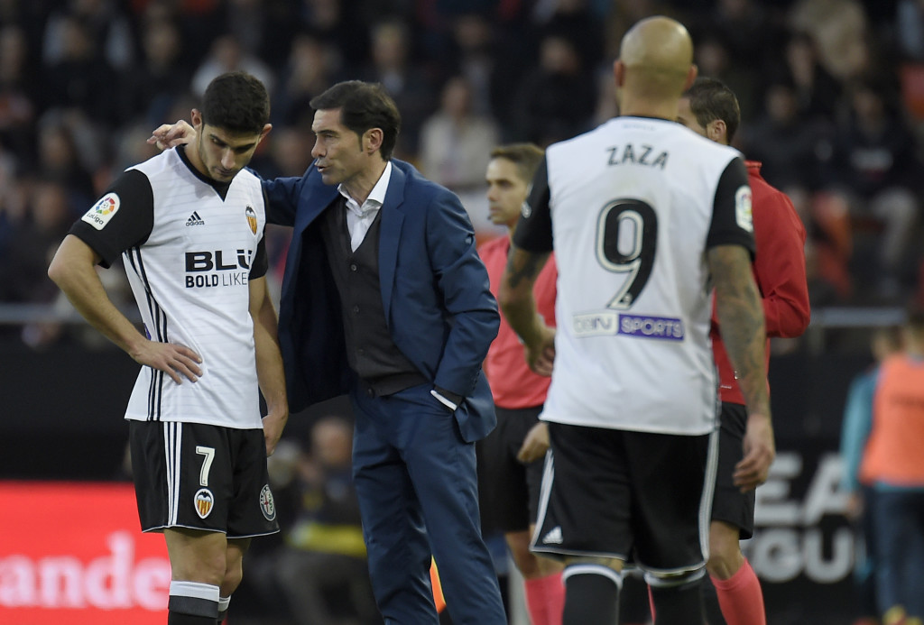 Valencia's coach Marcelino (R) speaks to Valencia's Portuguese midfielder Manuel Guedes (L) during the Spanish league football match Valencia CF and Villarreal CF at Mestalla stadium in Valencia on December 23, 2017. / AFP PHOTO / JOSE JORDAN (Photo credit should read JOSE JORDAN/AFP/Getty Images)