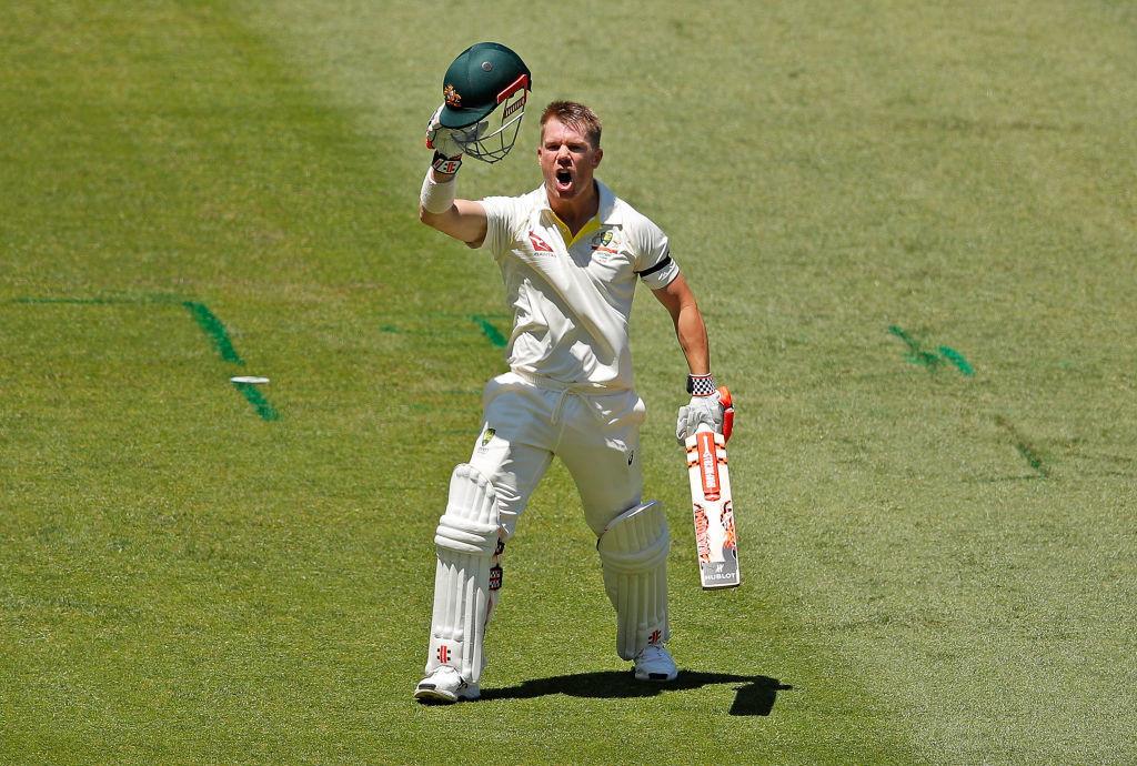 Warner exults after completing his 21st Test ton.