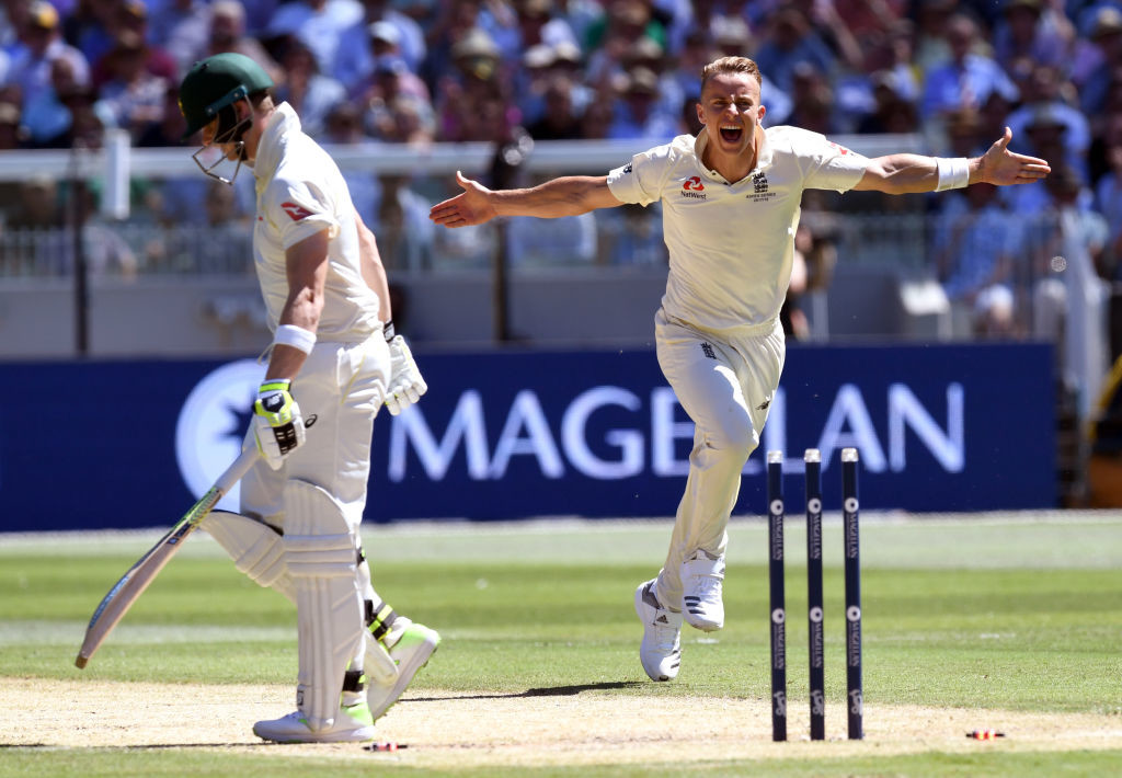Curran exults after sending back the Australian skipper.