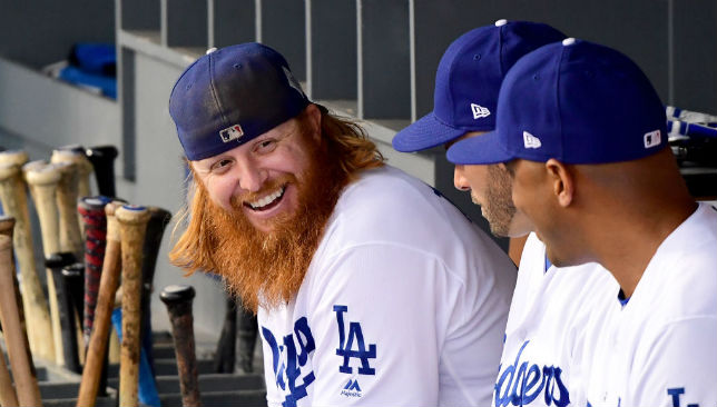 Popular Justin Turner of the Los Angeles Dodgers talks in the dugout before game seven of the 2017 World Series at Dodger Stadium.