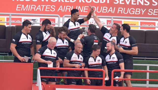 Exiles players celebrate their Dubai Sevens title in December.