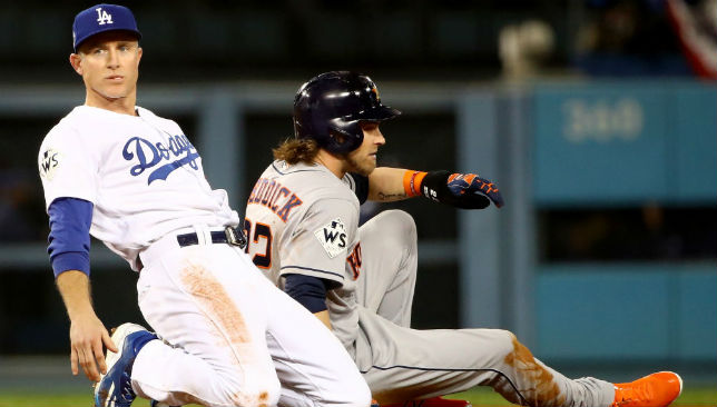 Utley forces out Josh Reddick of the Houston Astros during the seventh inning in game six of the 2017 World Series.