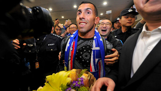 Carlos Tevez on his arrival to Shanghai las year.