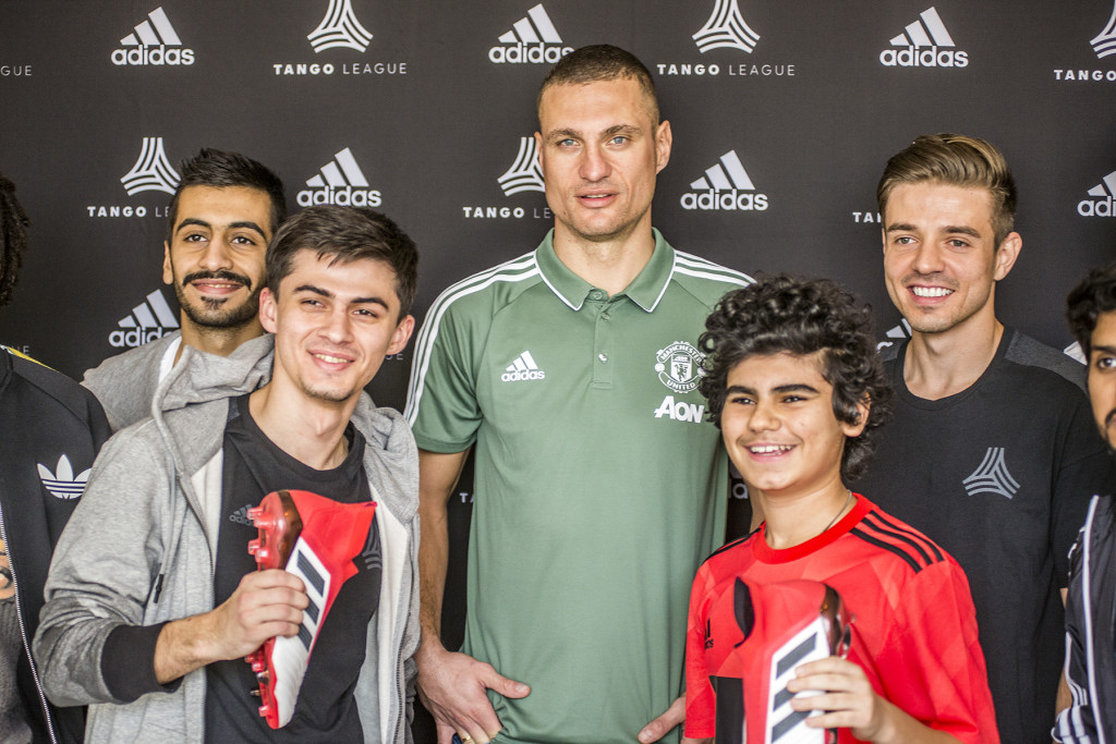 "Nemanja Vidic hands over the new adidas ""Cold Blooded"" Predator boot pack as he meets the adidas Dubai Tango League captains"