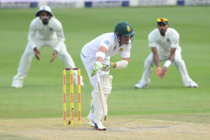 Dean Elgar is struck by a ball from Mohammed Shami of India during day three of the third Test