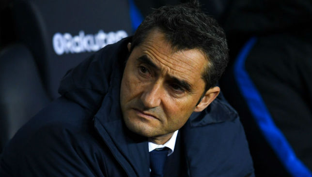 Barcelona coach Ernesto Valverde looks on.