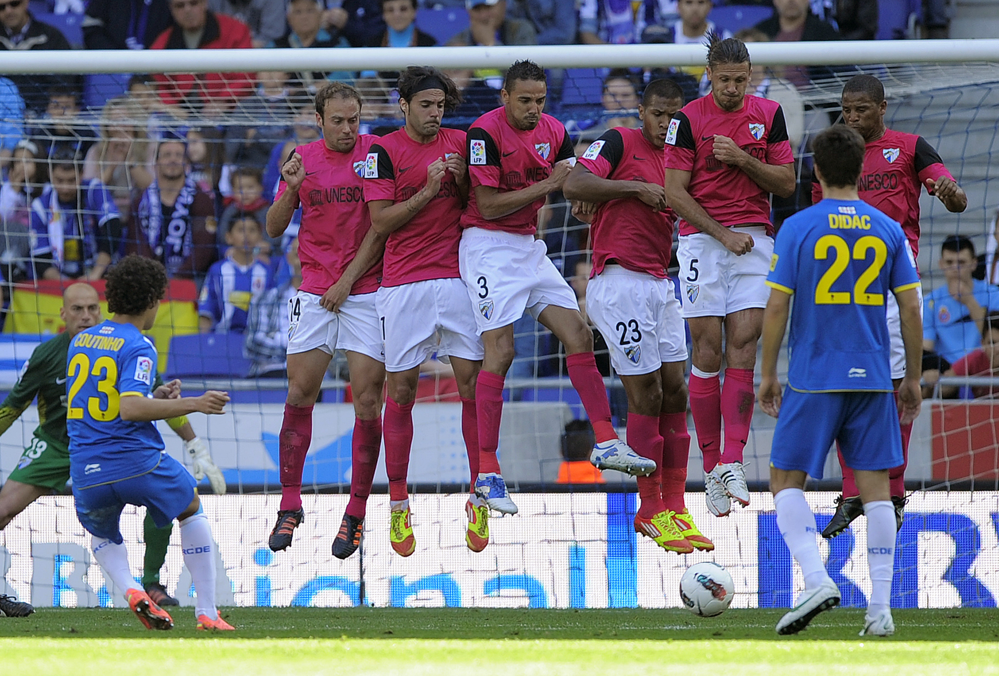 Coutinho scoring a free-kick against Malaga in 2012.