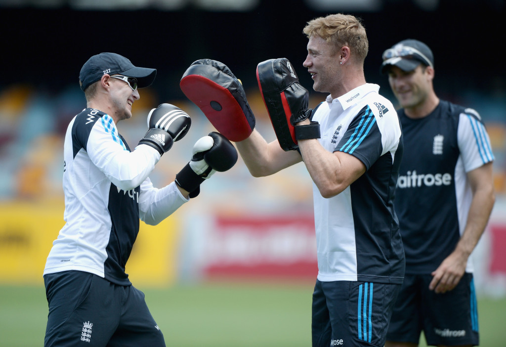 BRISBANE, AUSTRALIA - JANUARY 18: Former England cricketer Andrew Flintoff holds pads as Joe Root of England boxes ahead of a nets session at The Gabba on January 18, 2015 in Brisbane, Australia. (Photo by Gareth Copley/Getty Images)