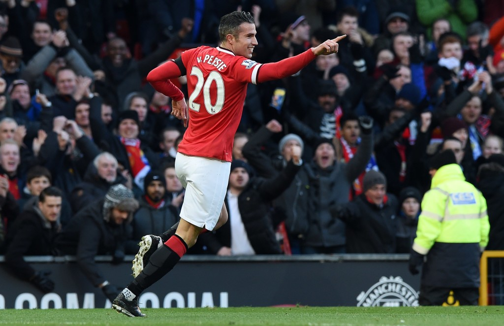 Robin van Persie celebrates scoring for Manchester United