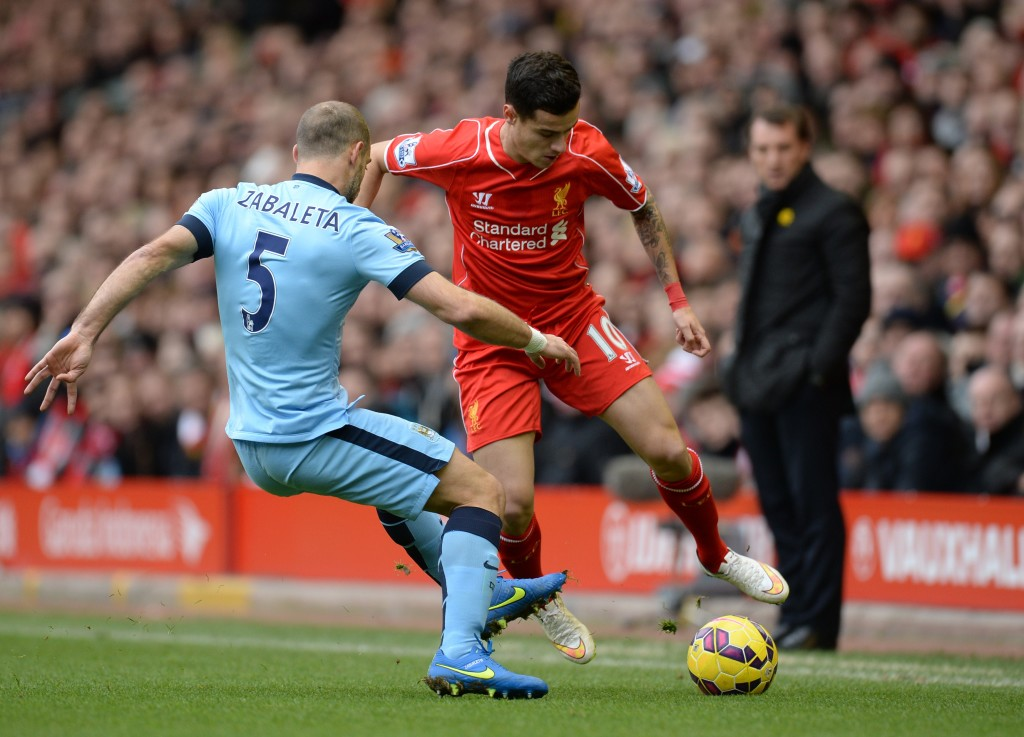 "Liverpool's Northern Irish manager Brendan Rodgers (R) watches as Manchester City's Argentinian defender Pablo Zabaleta (L) vies with Liverpool's Brazilian midfielder Philippe Coutinho during the English Premier League football match between Liverpool and Manchester City at the Anfield stadium in Liverpool, north west England, on March 1, 2015. AFP PHOTO / OLI SCARFF RESTRICTED TO EDITORIAL USE. NO USE WITH UNAUTHORIZED AUDIO, VIDEO, DATA, FIXTURE LISTS, CLUB/LEAGUE LOGOS OR ""LIVE"" SERVICES. ONLINE IN-MATCH USE LIMITED TO 45 IMAGES, NO VIDEO EMULATION. NO USE IN BETTING, GAMES OR SINGLE CLUB/LEAGUE/PLAYER PUBLICATIONS. (Photo credit should read OLI SCARFF/AFP/Getty Images)"