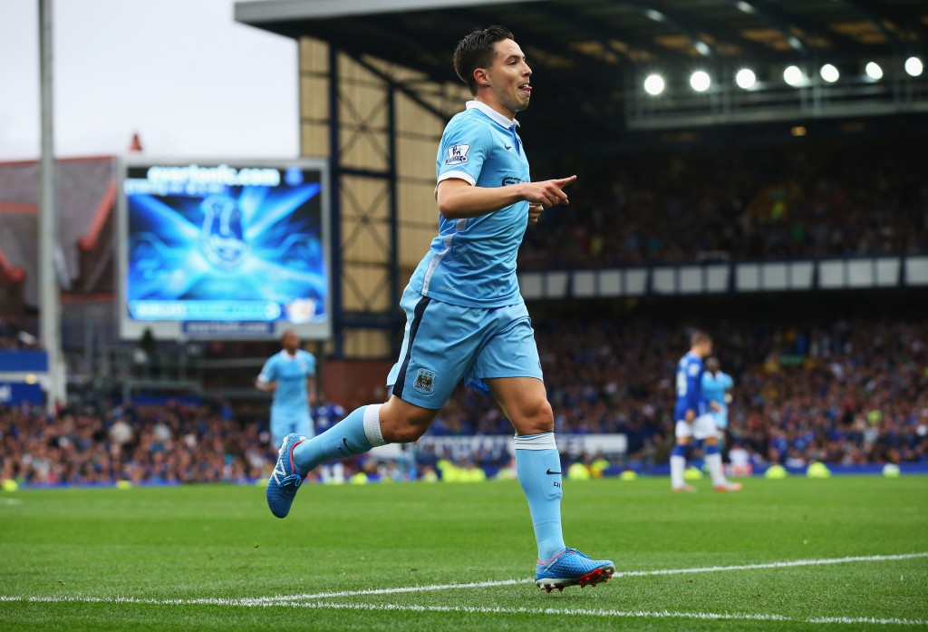 Samir Nasri celebrates scoring for Manchester City against Everton