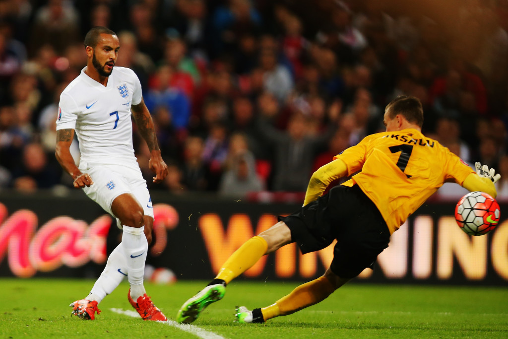 LONDON, ENGLAND - OCTOBER 09: (L-R) Theo Walcott of England shoots and scores the first goal past Mihkel Aksalu of Estonia during the UEFA EURO 2016 Group E qualifying match between England and Estonia at Wembley on October 9, 2015 in London, United Kingdom. (Photo by Bryn Lennon/Getty Images)