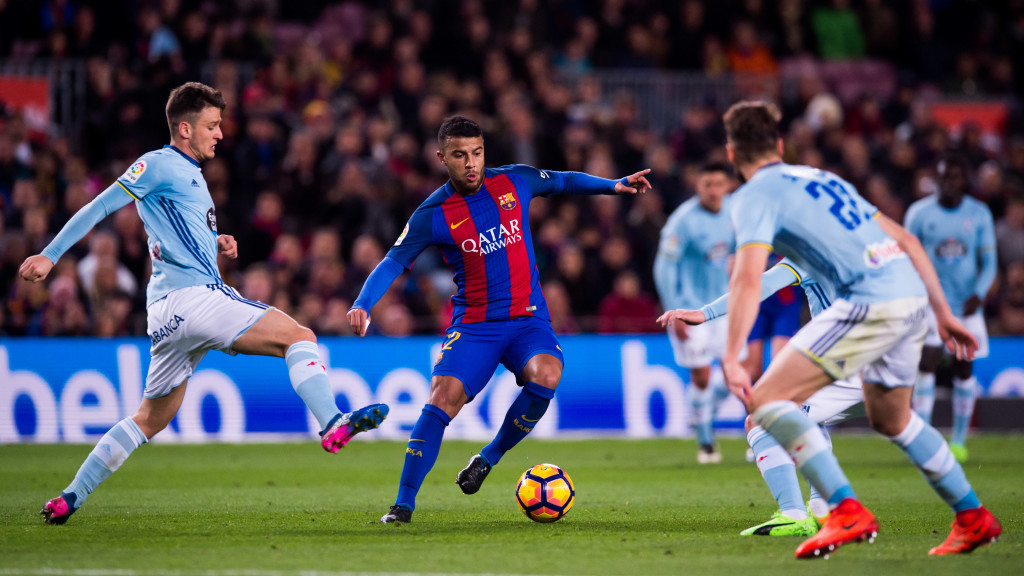 BARCELONA, SPAIN - MARCH 04: Rafinha (C) of FC Barcelona dribbles Nemanja Radoja (L) of RC Celta de Vigo during the La Liga match between FC Barcelona and RC Celta de Vigo at Camp Nou stadium on March 4, 2017 in Barcelona, Spain. (Photo by Alex Caparros/Getty Images)