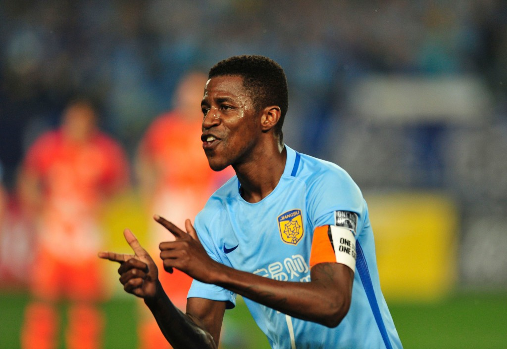 Ramires Santos of Jiangsu FC celebrates after scoring a goal during the AFC Champions League group stage football match against Jeju United FC in Nanjing, east China's Jiangsu province, on April 25, 2017. / AFP PHOTO / STR (Photo credit should read STR/AFP/Getty Images)