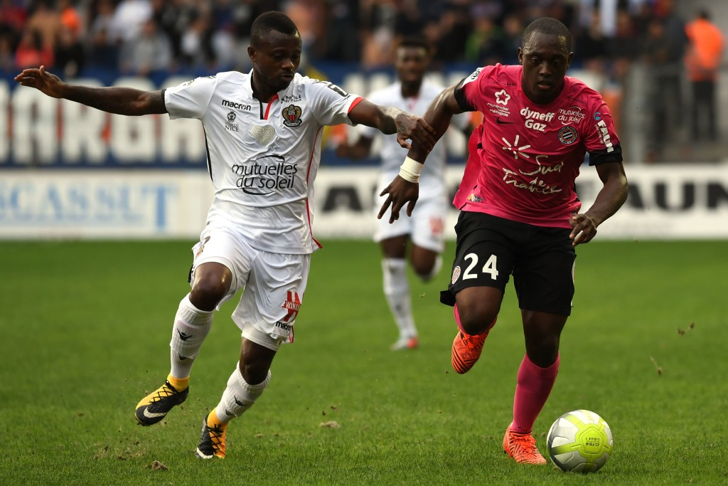 Nice's Ivorian midfielder Jean Michael Seri (L) vies with Montpellier's French defender Jerome Roussillon (R) during the French L1 football match between MHSC Montpellier and Nice, on October 15, 2017 at the La Mosson Stadium in Montpellier, southern France. / AFP PHOTO / PASCAL GUYOT (Photo credit should read PASCAL GUYOT/AFP/Getty Images)