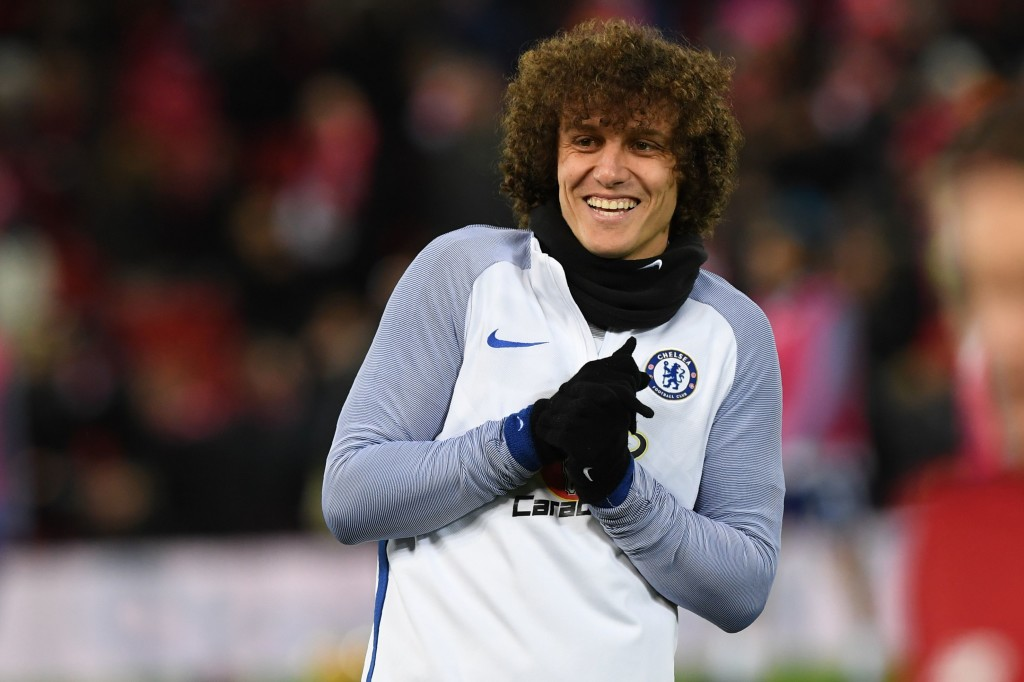 Chelsea's Brazilian defender David Luiz warms up on the pitch ahead of the English Premier League football match between Liverpool and Chelsea at Anfield in Liverpool, north west England on November 25, 2017. / AFP PHOTO / Paul ELLIS / RESTRICTED TO EDITORIAL USE. No use with unauthorized audio, video, data, fixture lists, club/league logos or 'live' services. Online in-match use limited to 75 images, no video emulation. No use in betting, games or single club/league/player publications. / (Photo credit should read PAUL ELLIS/AFP/Getty Images)