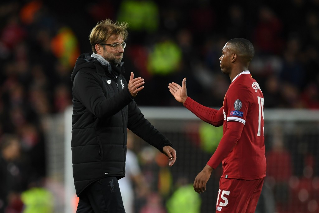 Liverpool's German manager Jurgen Klopp (L) shakes hands with Liverpool's English striker Daniel Sturridge (R) at the end of the UEFA Champions League Group E football match between Liverpool and Spartak Moscow at Anfield in Liverpool, north-west England on December 6, 2017. / AFP PHOTO / Paul ELLIS (Photo credit should read PAUL ELLIS/AFP/Getty Images)
