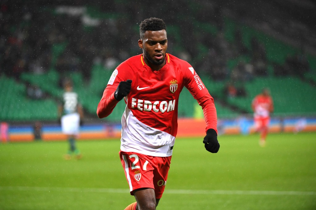 Monacos French midfielder Thomas Lemar (C) celebrates after scoring a goal during the French L1 football match between Saint-Etienne (ASSE) and Monaco (ASM) on December 15, 2017, at the Geoffroy Guichard stadium in Saint-Etienne, central-eastern France. / AFP PHOTO / ROMAIN LAFABREGUE (Photo credit should read ROMAIN LAFABREGUE/AFP/Getty Images)
