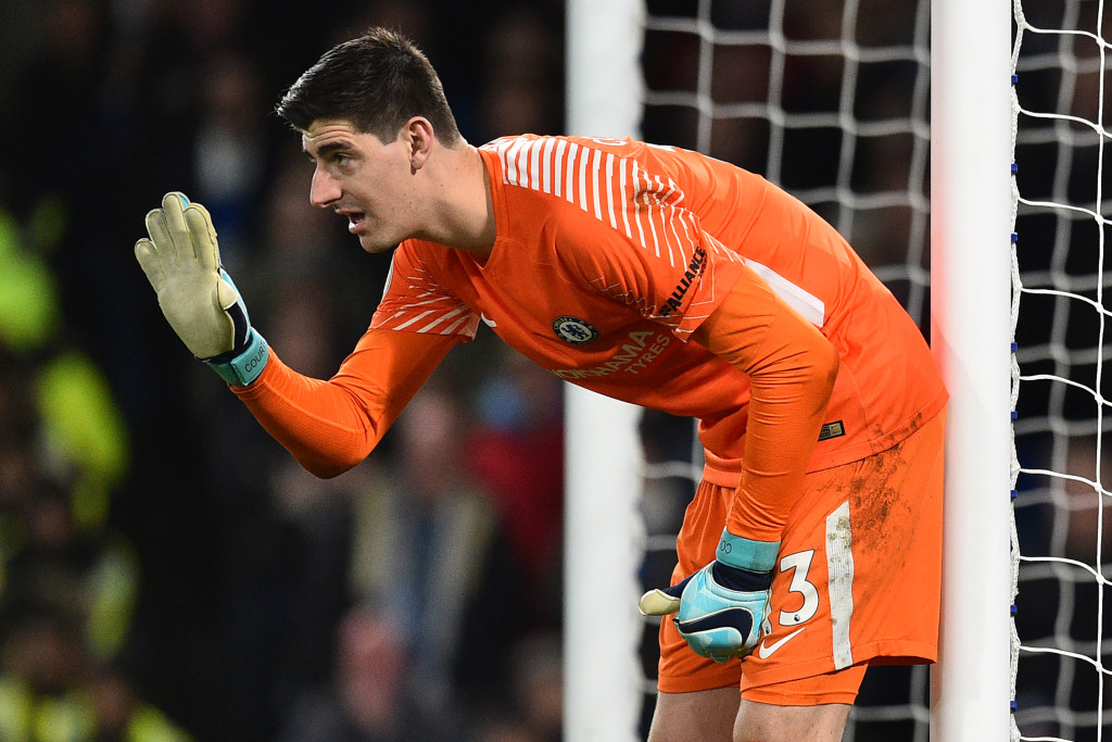 Chelsea's Belgian goalkeeper Thibaut Courtois lines up his defence during the English Premier League football match between Chelsea and Brighton and Hove Albion at Stamford Bridge in London on December 26, 2017. / AFP PHOTO / Glyn KIRK / RESTRICTED TO EDITORIAL USE. No use with unauthorized audio, video, data, fixture lists, club/league logos or 'live' services. Online in-match use limited to 75 images, no video emulation. No use in betting, games or single club/league/player publications. / (Photo credit should read GLYN KIRK/AFP/Getty Images)