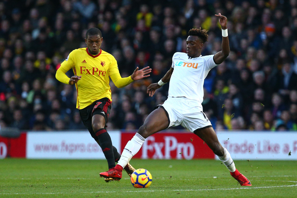 WATFORD, ENGLAND - DECEMBER 30: Tammy Abraham of Swansea City is challenged by Christian Kabasele of Watford during the Premier League match between Watford and Swansea City at Vicarage Road on December 30, 2017 in Watford, England. (Photo by Charlie Crowhurst/Getty Images)