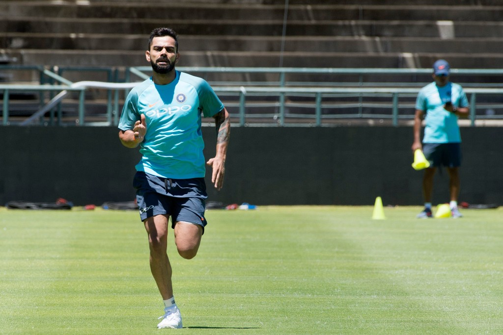 India's right handed batsman and captain Virat Kohli runs during a training session at the Newlands Cricket ground on January 3, 2018, in Cape Town, prior to the first of three cricket tests matches between South Africa and India. / AFP PHOTO / RODGER BOSCH (Photo credit should read RODGER BOSCH/AFP/Getty Images)