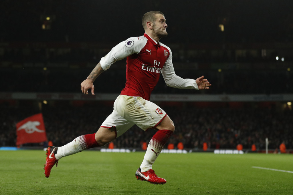 Arsenal's English midfielder Jack Wilshere celebrates after scoring during the English Premier League football match between Arsenal and Chelsea at the Emirates Stadium in London on January 3, 2018. / AFP PHOTO / Adrian DENNIS / RESTRICTED TO EDITORIAL USE. No use with unauthorized audio, video, data, fixture lists, club/league logos or 'live' services. Online in-match use limited to 75 images, no video emulation. No use in betting, games or single club/league/player publications. / (Photo credit should read ADRIAN DENNIS/AFP/Getty Images)